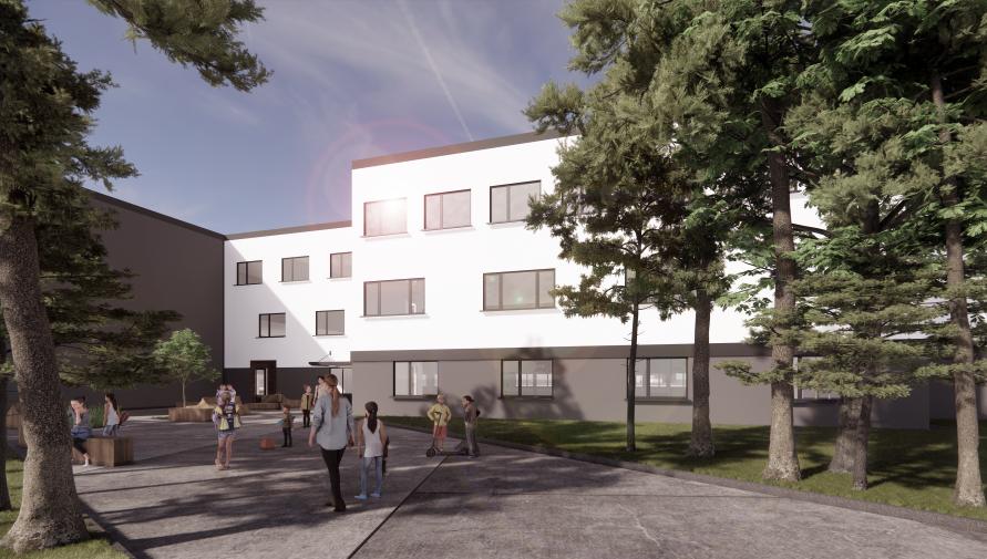 Projekt budynku szkoły - biały budynek za drzewami, na chodniku z przodu kilkoro osób.